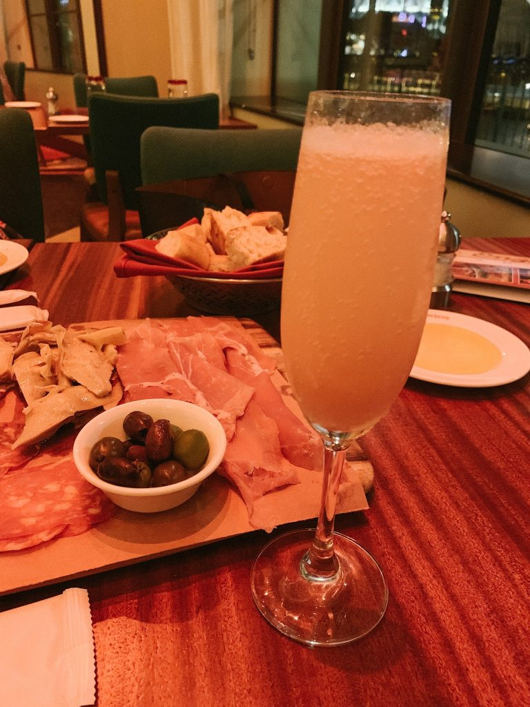 drinks, bread and antipasti trio at Maria & Enzo's Disney Springs