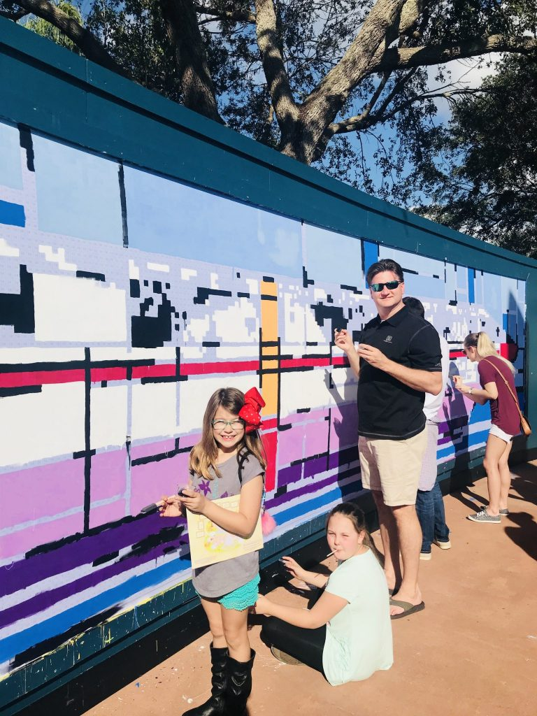 Painting the mural at the Epcot Festival of the Arts