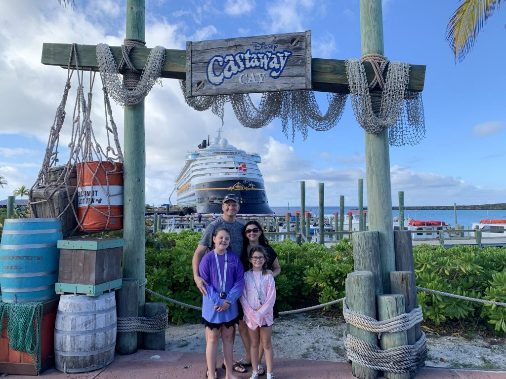 Castaway Cay Family picture with arrival sign