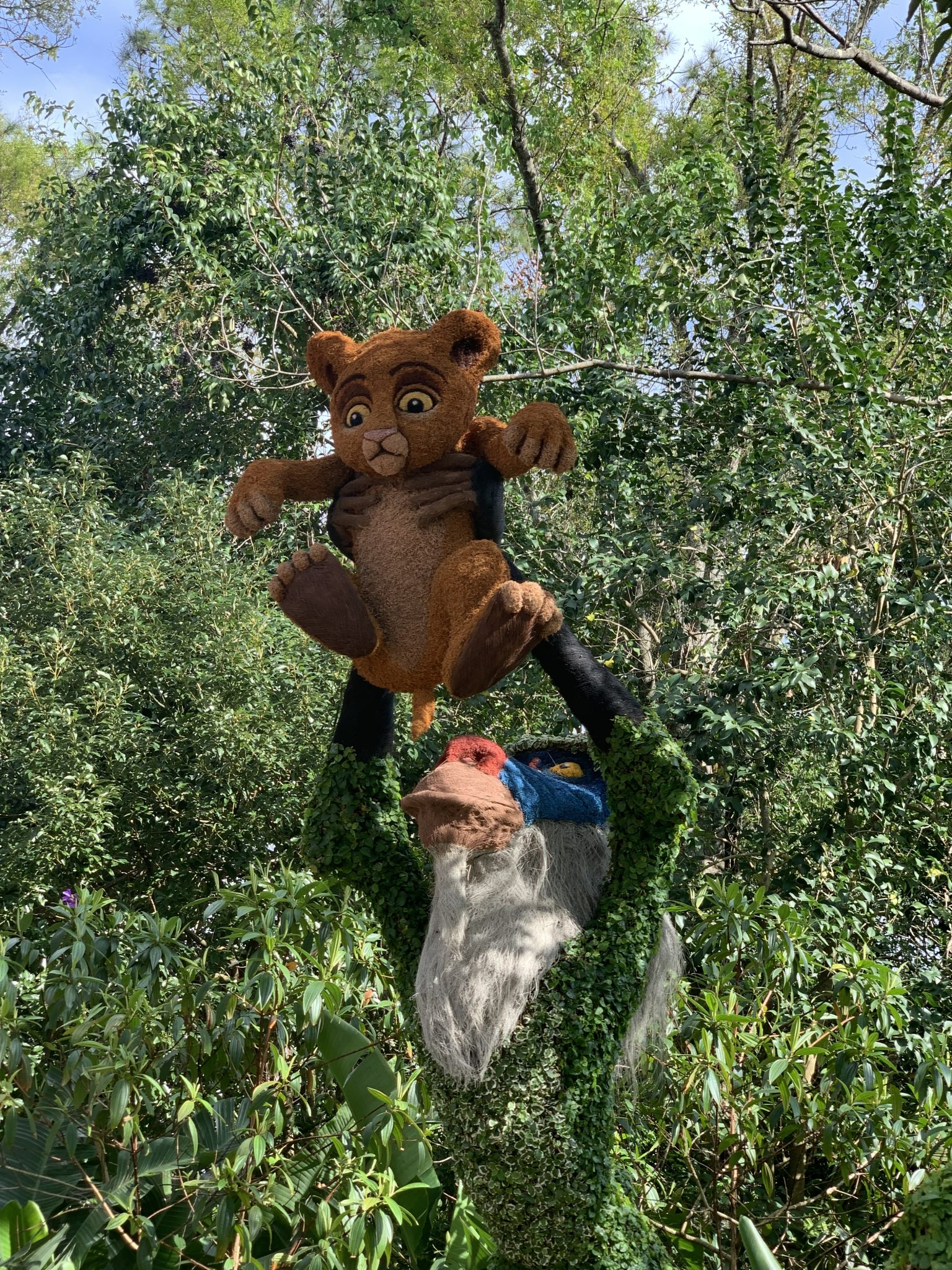 Simba being held high by Rafiki topiary at Epcot Flower and Garden Festival