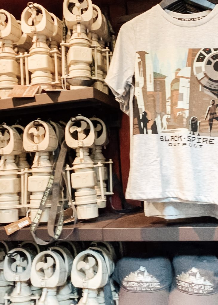 Fans, tshirts and hats at the Marketplace in Star Wars Galaxys Edge