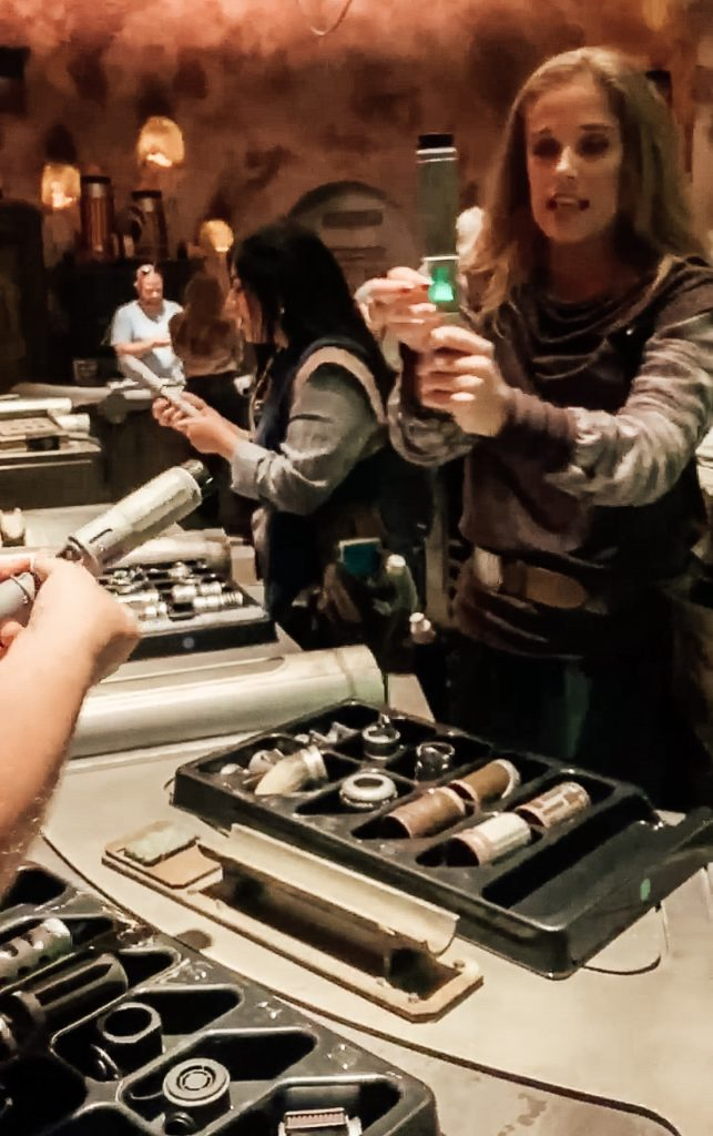 lightsaber building at Savi's Workshop Star Wars Galaxy's Edge