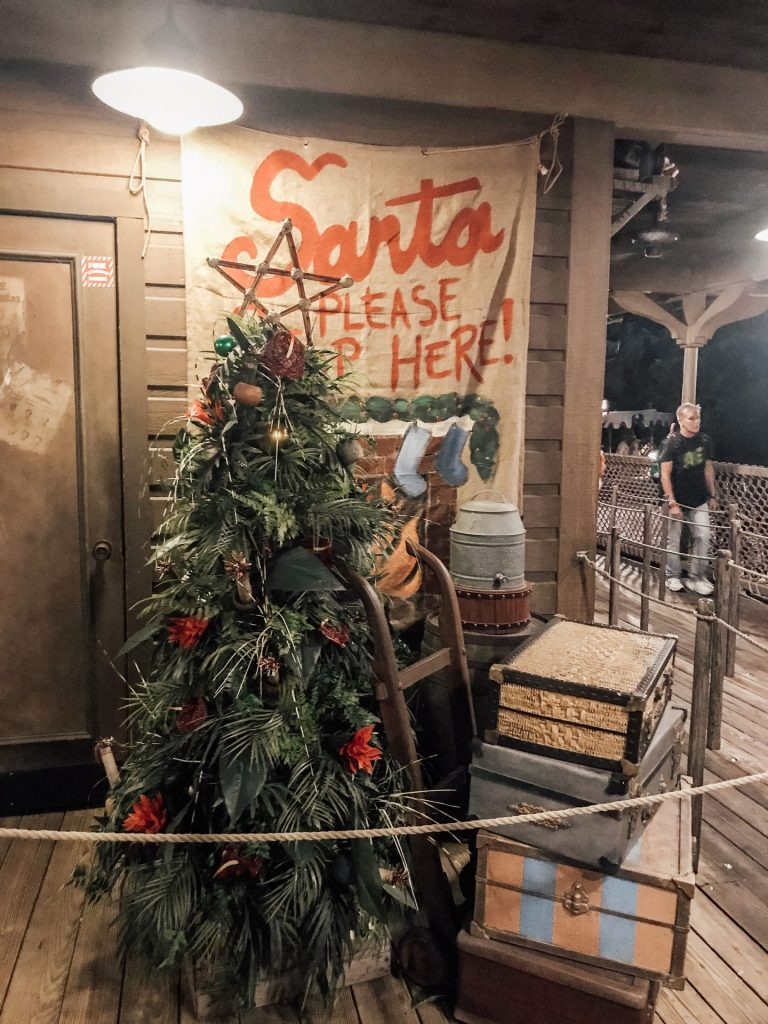 Jingle Cruise Christmas attraction ride overlay Mickey's Very Merry Christmas Party treat stations