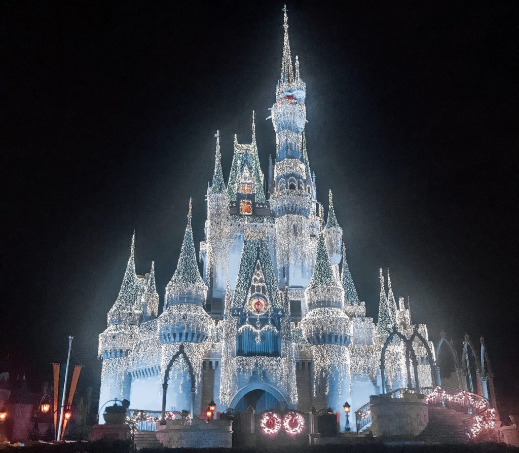 Elsa lights up Cinderellas Castle nightly at Magic Kingdom for the holidays