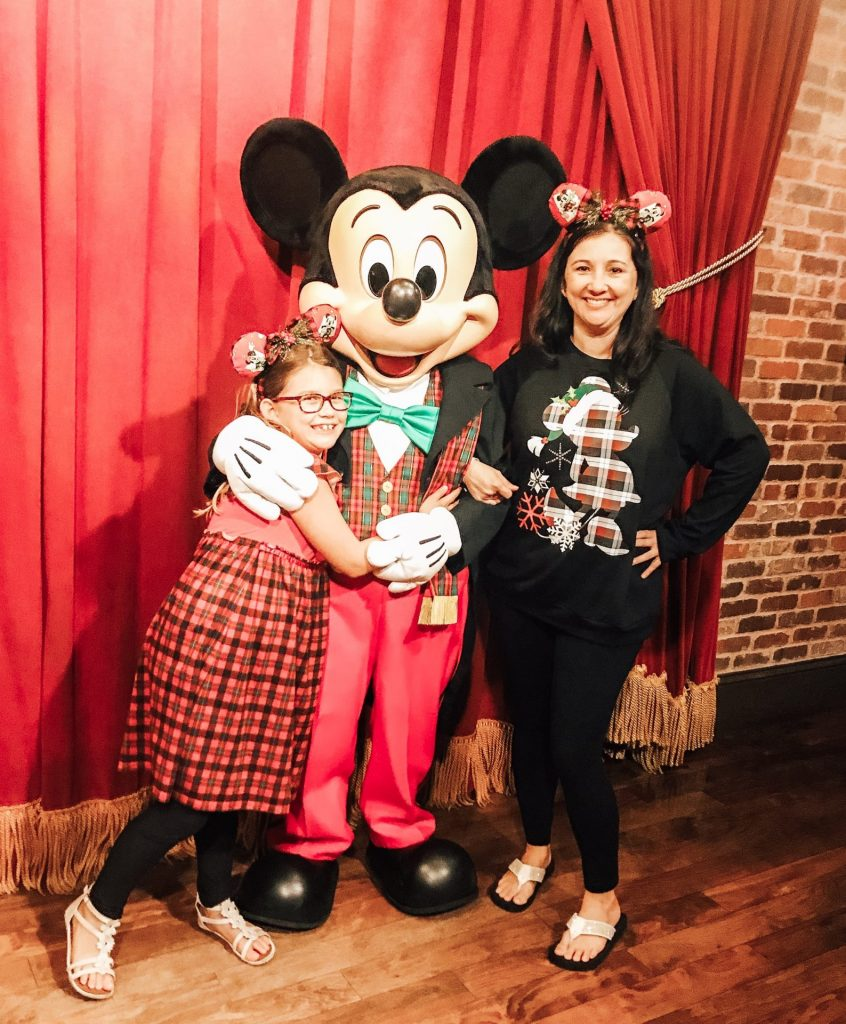 Meet Mickey in his Christmas Party attire in the Town Square Theater at Mickey's Very Merry Christmas Party