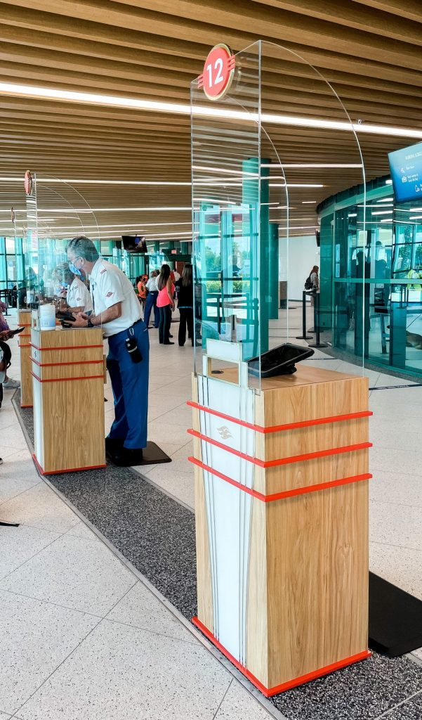 Passport birth certificate check station at Disney Cruise Terminal Port Canaveral